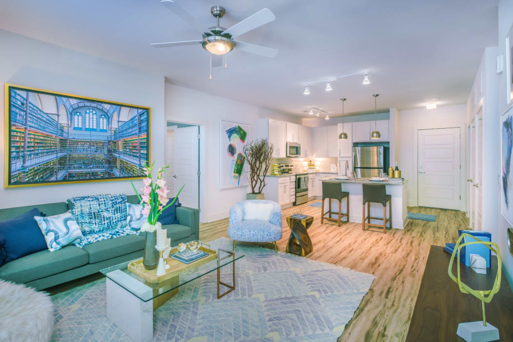 Spacious living room in a beachy looking modern home at Blu at Northline Apartments in Charlotte, North Carolina