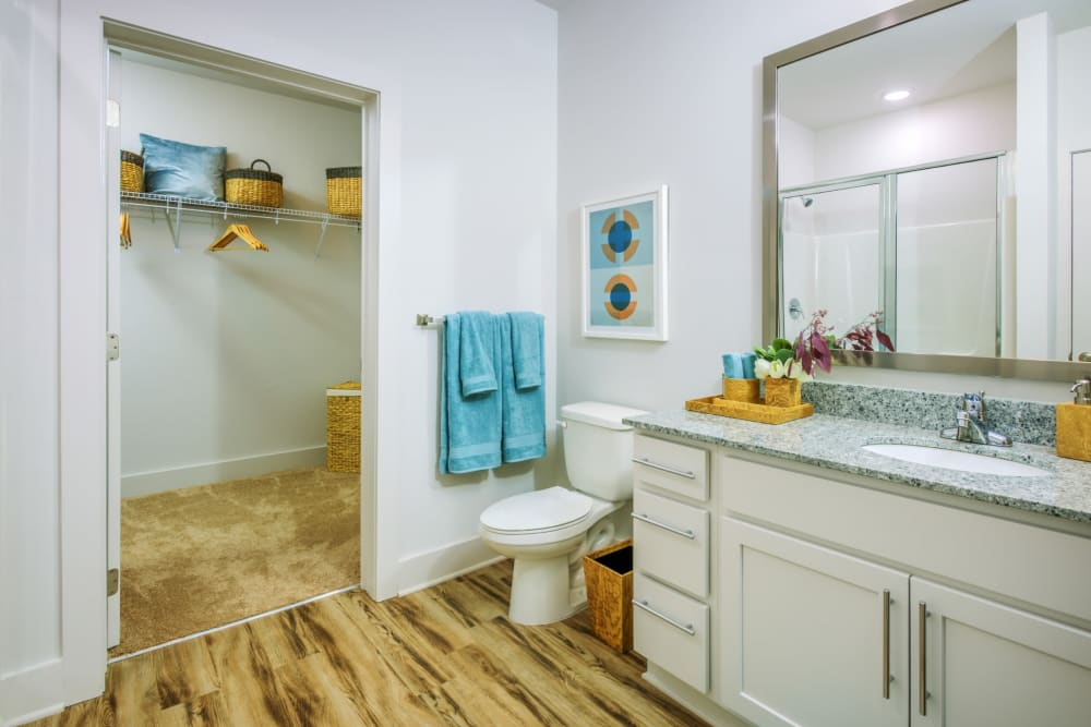 Bathroom with large closet and gorgeous hardwood floors at Blu at Northline Apartments in Charlotte, North Carolina