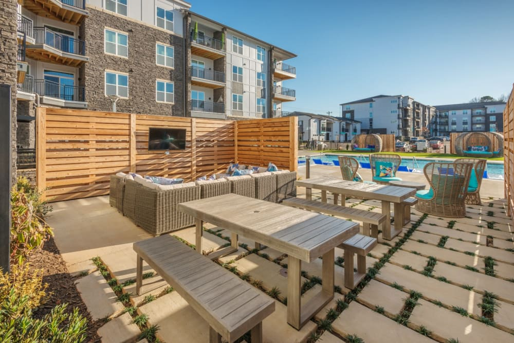 Awesome outdoor lounge area with a tv at Blu at Northline Apartments in Charlotte, North Carolina