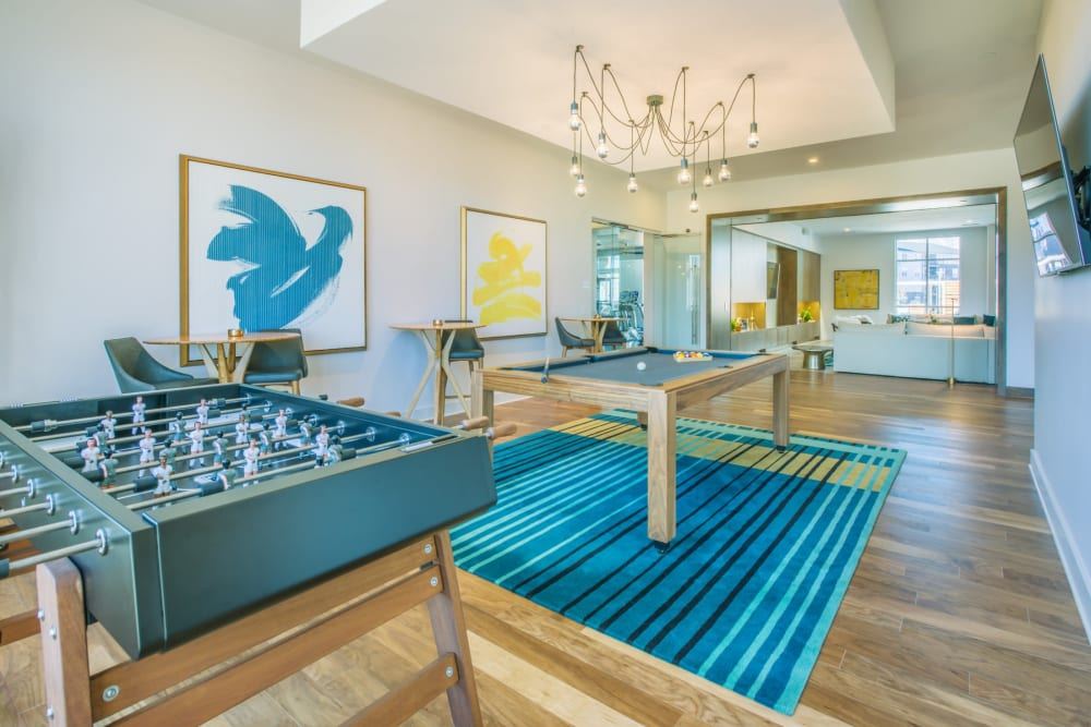 Game area in the clubhouse with foosball and pool at Blu at Northline Apartments in Charlotte, North Carolina