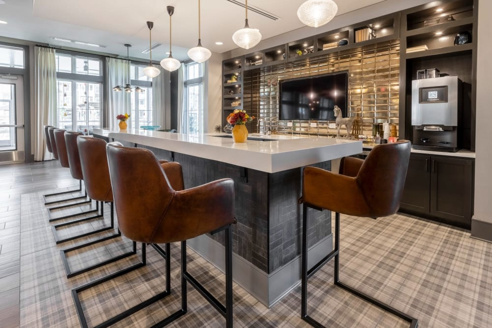 Tall bar area with lots of seats for residents to have coffee or drinks in at Parc at Murfreesboro in Murfreesboro, Tennessee