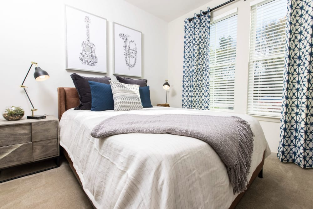 Beautifully decorated bedroom with tons of natural light at Parc at Murfreesboro in Murfreesboro, Tennessee