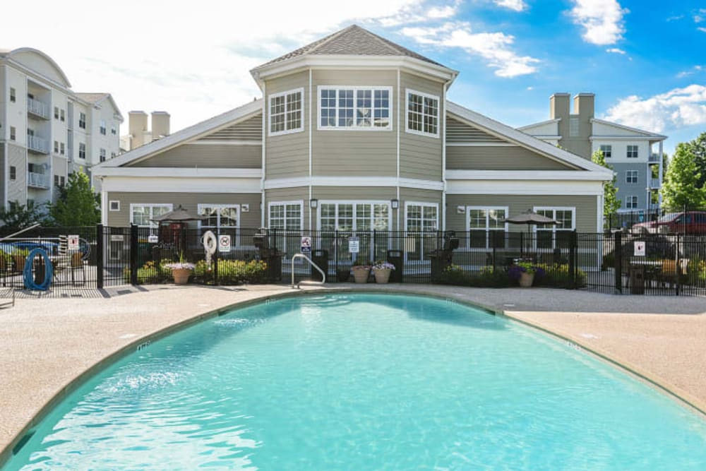 Swimming pool in front of clubhouse at Sofi Danvers in Danvers, Massachusetts