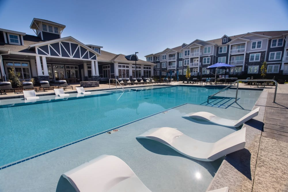 Lounge chairs in the water so you can swim up and relax at Parc at Murfreesboro in Murfreesboro, Tennessee