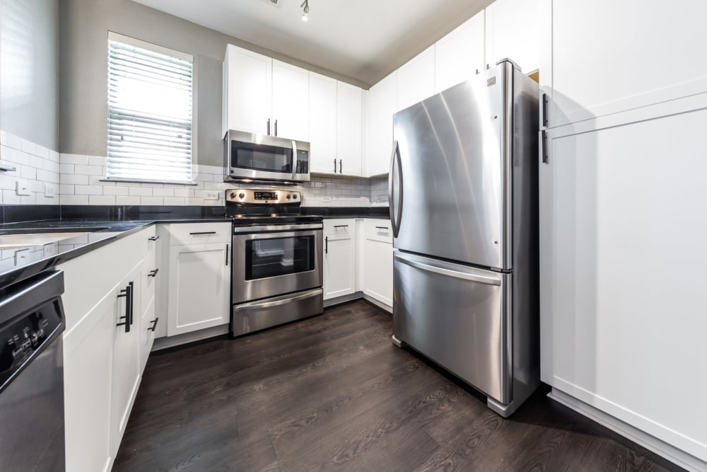 Kitchen with stainless steel appliances at ln in Dallas, Texas