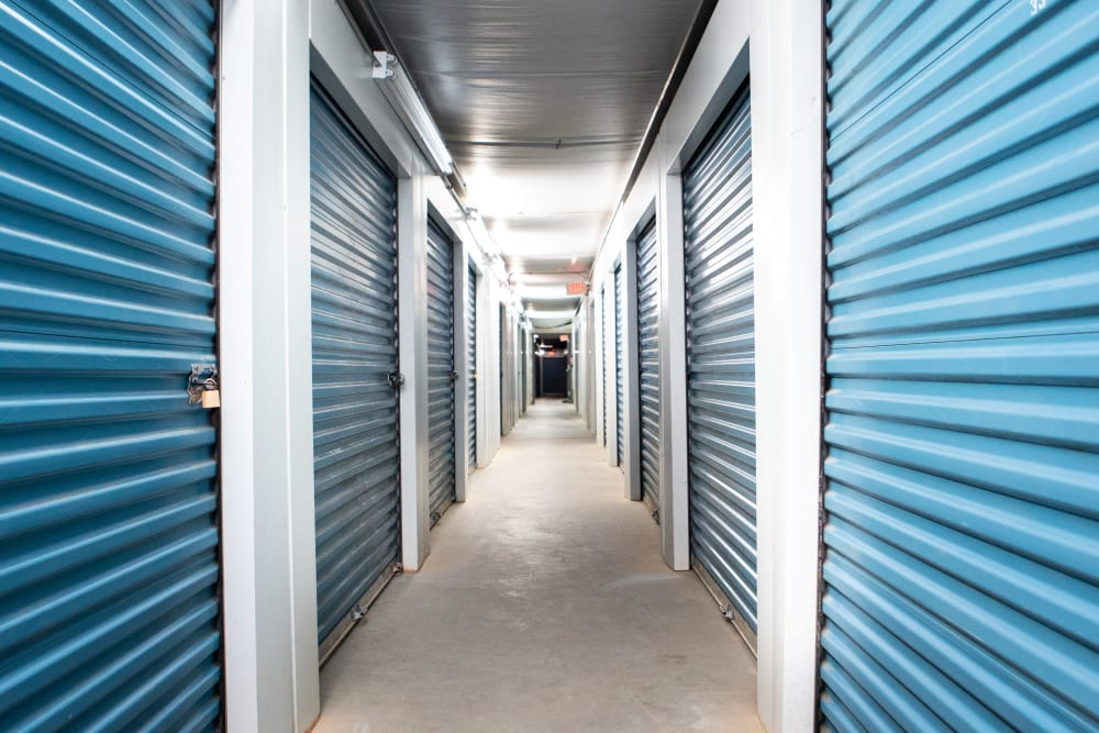 Indoor storage units with blue doors in Thomasville, North Carolina at AAA Self Storage of Thomasville
