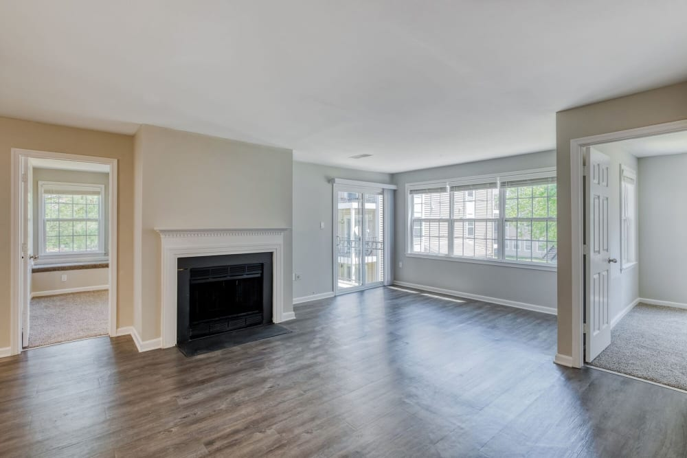 Upgraded living room with fireplace at Abbotts Run Apartments in Alexandria, Virginia
