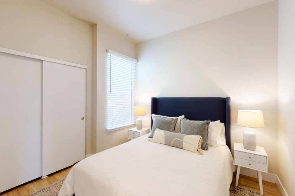 Bedroom with wood style floors at Brookside Apartments in Gresham, Oregon
