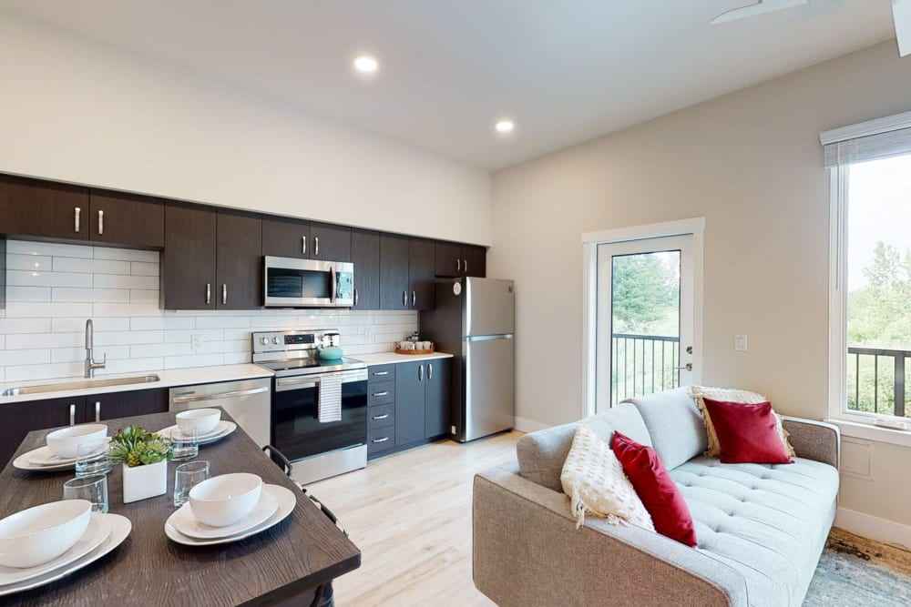 Kitchen with wood style floors at Brookside Apartments in Gresham, Oregon