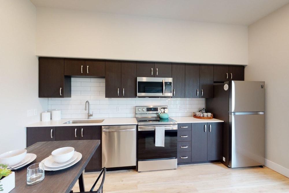 Kitchen with modern appliances at Brookside Apartments in Gresham, Oregon