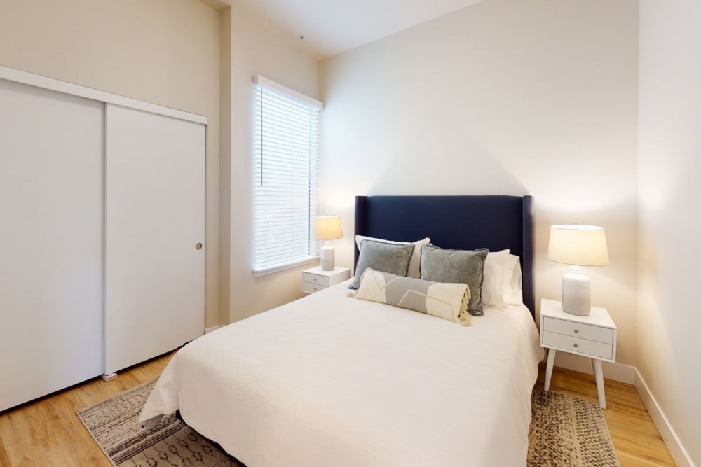 Model bedroom with wood style floors at Brookside Apartments in Gresham, Oregon