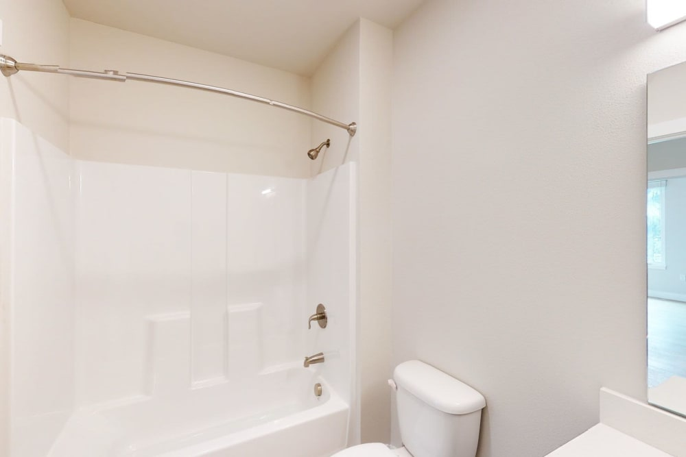 Bathroom with a shower tub at Brookside Apartments in Gresham, Oregon