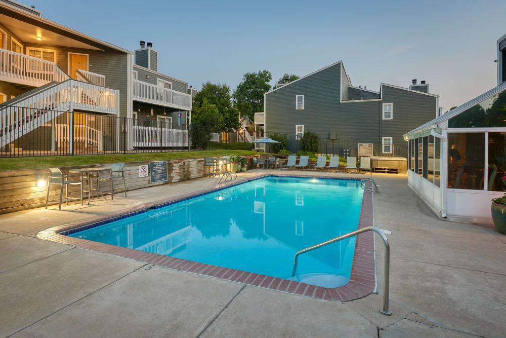 Beautiful resort-style swimming pool at sunset at Bluesky Landing Apartments in Lakewood, Colorado