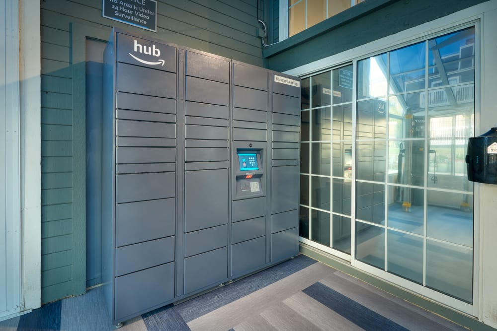 Fitness equipment and Amazon Package Locker  at Bluesky Landing Apartments in Lakewood, Colorado