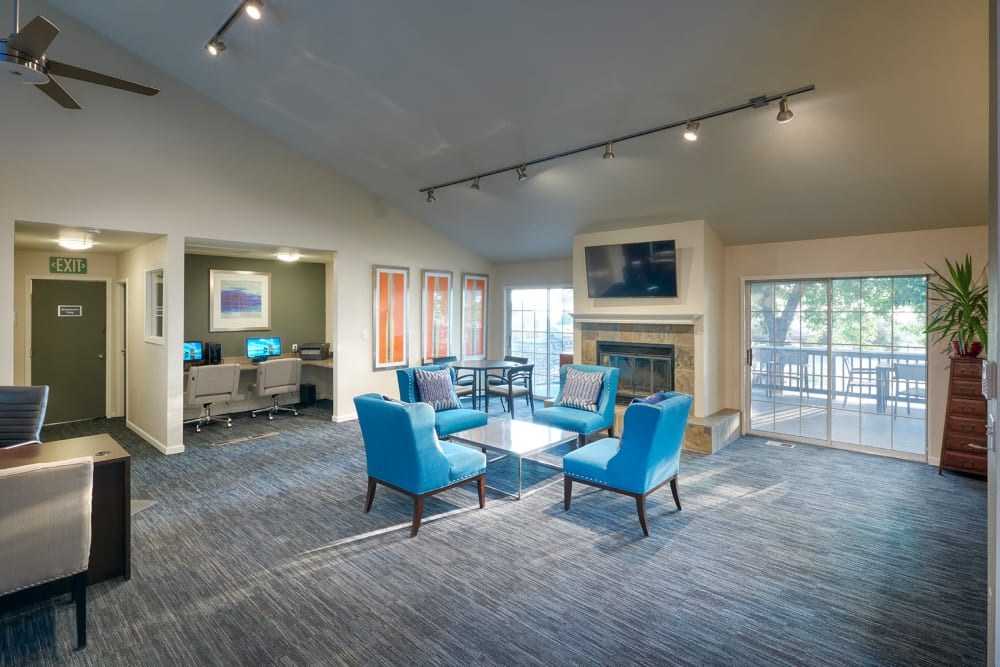 Blue chairs in the community clubhouse at Bluesky Landing Apartments in Lakewood, Colorado