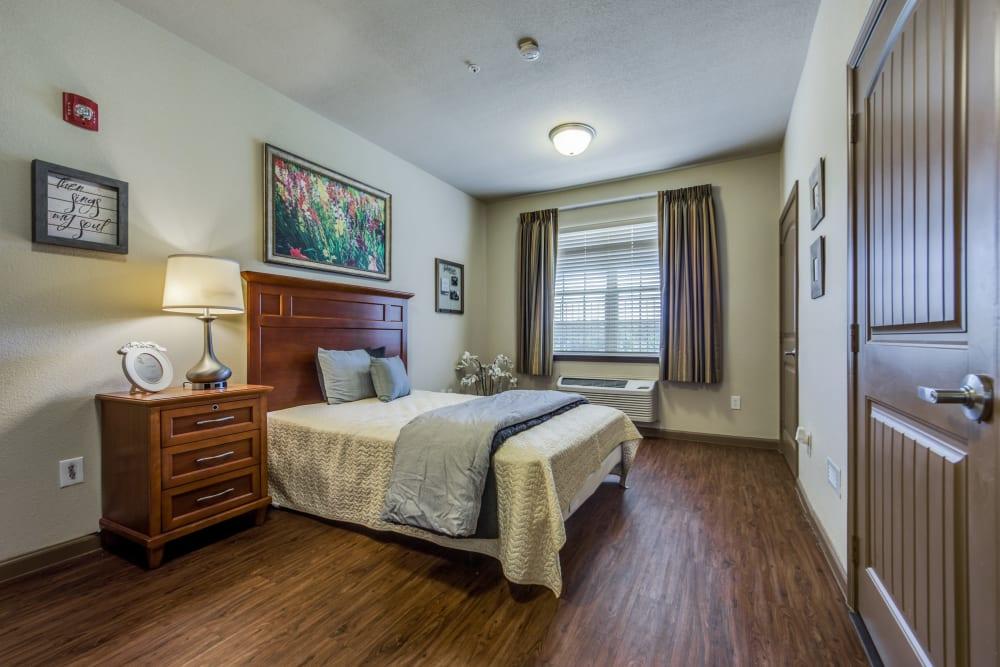 Spacious resident bedroom at The Landing at Stone Oak in San Antonio, Texas