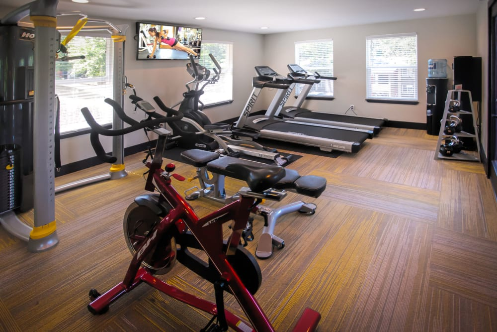Spin bikes and cardio machines in the fitness center at Haven Apartment Homes in Kent, Washington