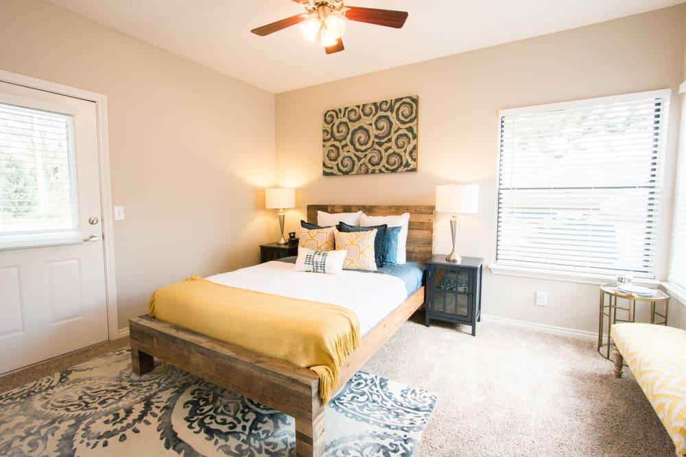 Large master bedroom with plush carpet at Ashford Belmar in Lakewood, Colorado
