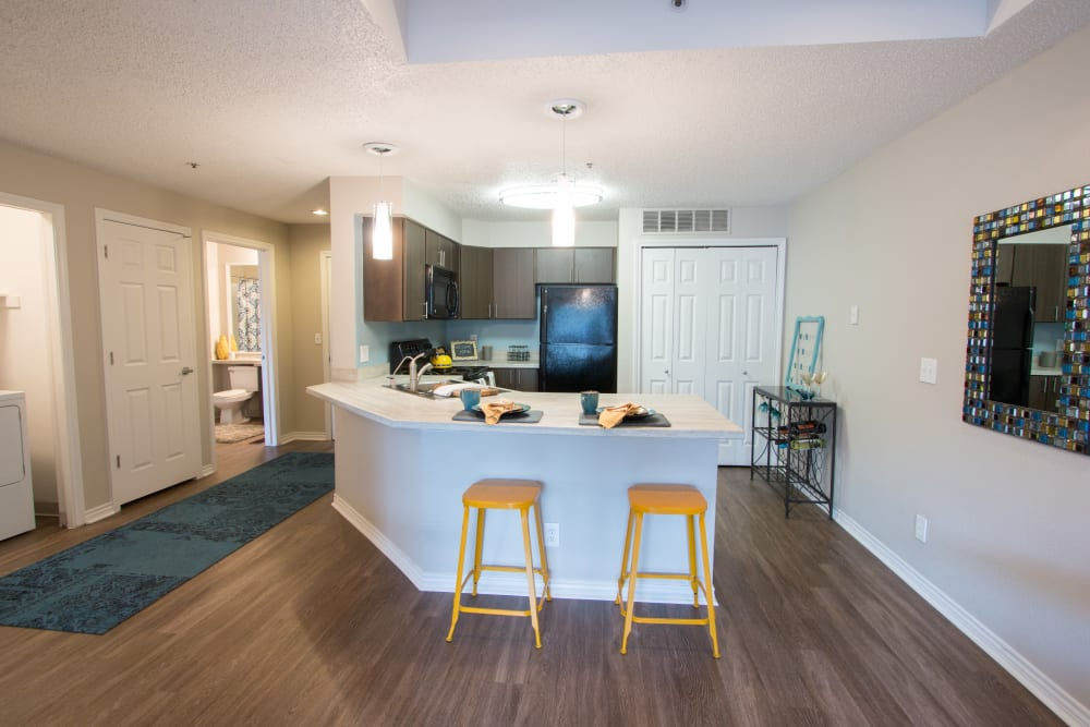Luxury upgraded kitchen offering expansive island at Ashford Belmar in Lakewood, Colorado