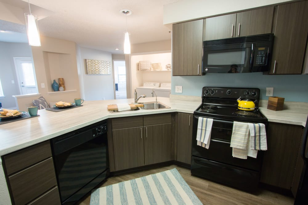 Spacious kitchen with ample cabinet space and granite countertops at Ashford Belmar in Lakewood, Colorado