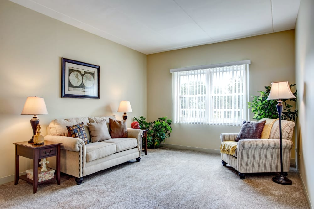 Furnished senior apartment living room at Hanover Place in Tinley Park, Illinois