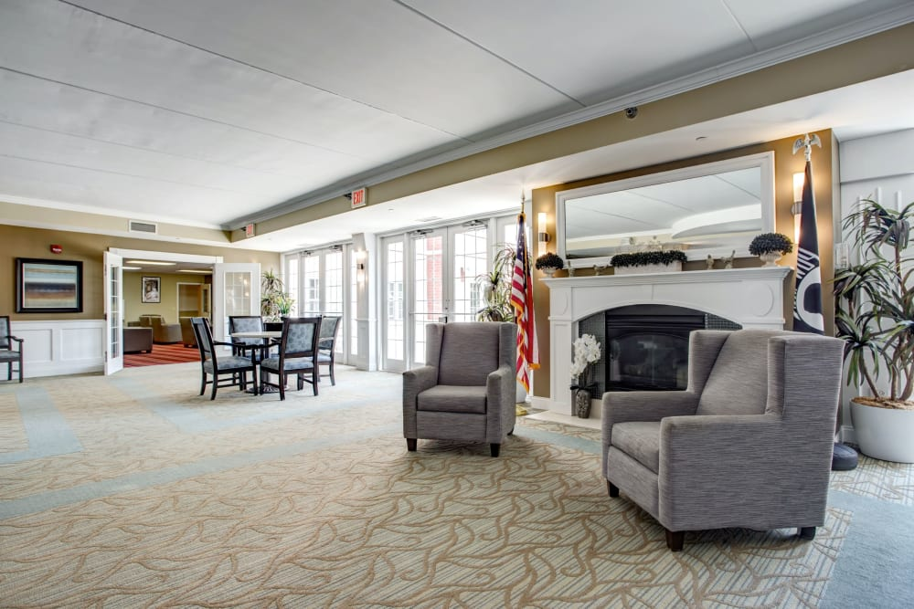Fireplace lounge with double doors leading outside at Hanover Place in Tinley Park, Illinois