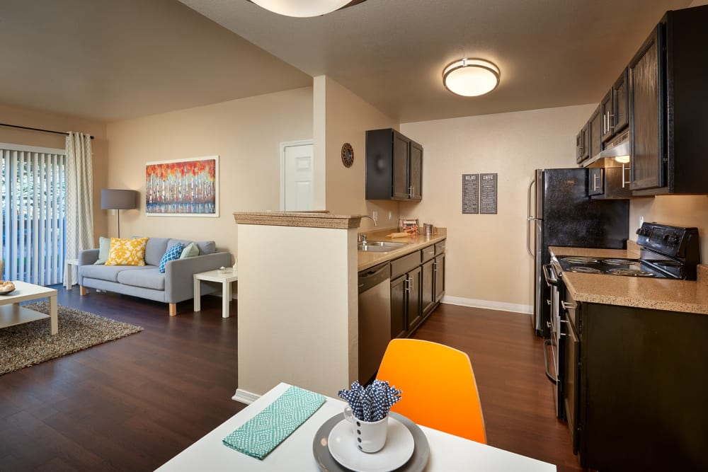 A kitchen with plenty of cabinet space at Crossroads at City Center Apartments in Aurora, Colorado