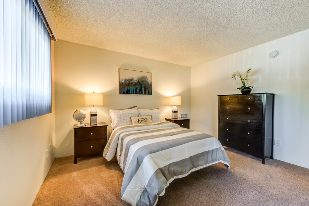 Large carpeted bedroom with window at The Diplomat, in Studio City, CA