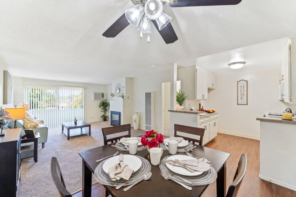 Dining table overlooking kitchen and living room areas at The Diplomat in Studio City, CA