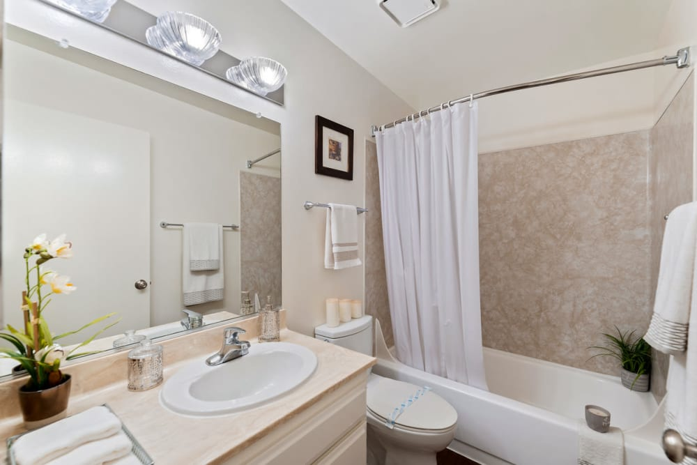 Bright bathroom with full size bathtub at The Diplomat in Studio City, CA
