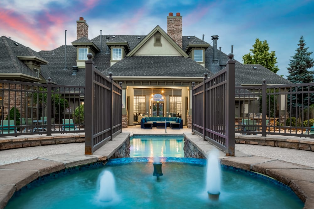 Pool with small fountains facing the clubhouse at Marquis at Town Centre in Broomfield, Colorado
