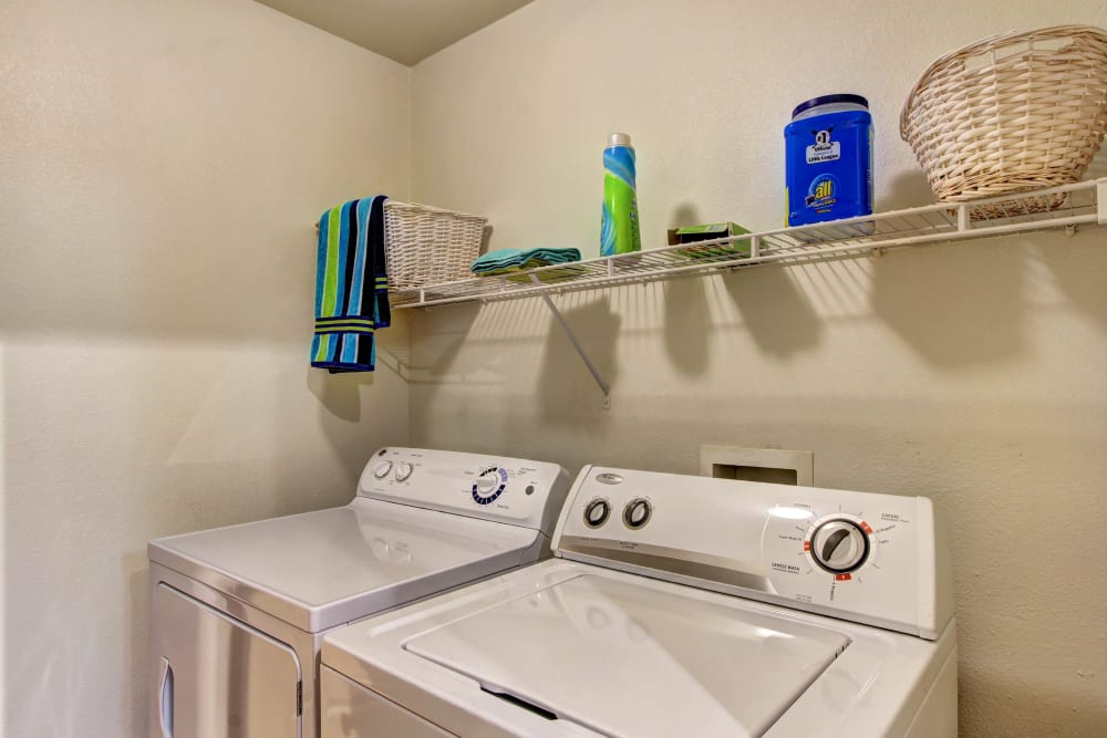 In unit washer and dryer at Marquis at The Woodlands in Spring, Texas