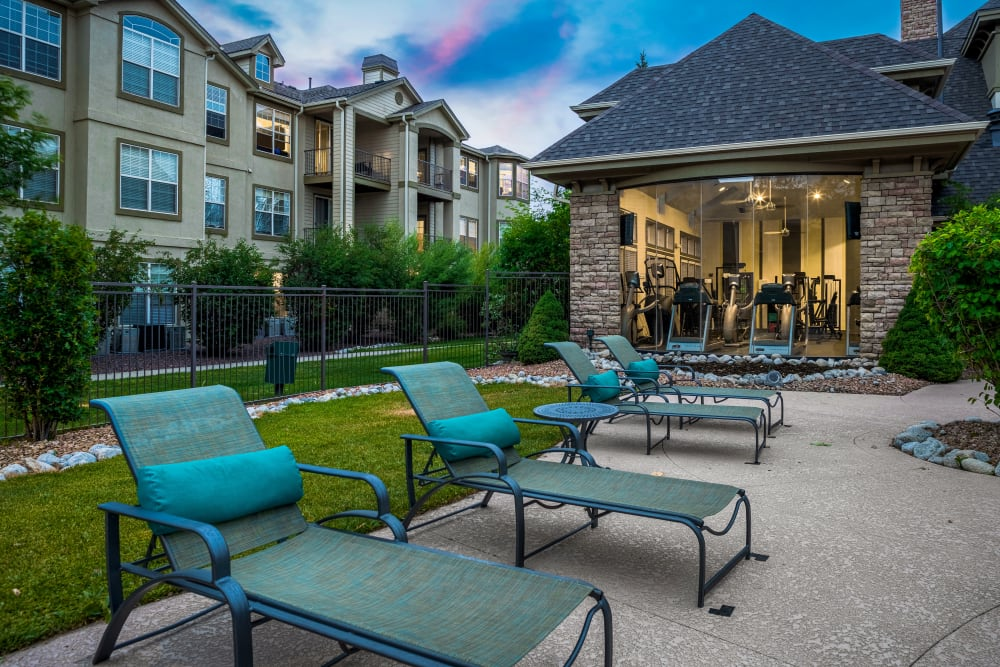 Lounge chairs poolside during sunset at Marquis at Town Centre in Broomfield, Colorado