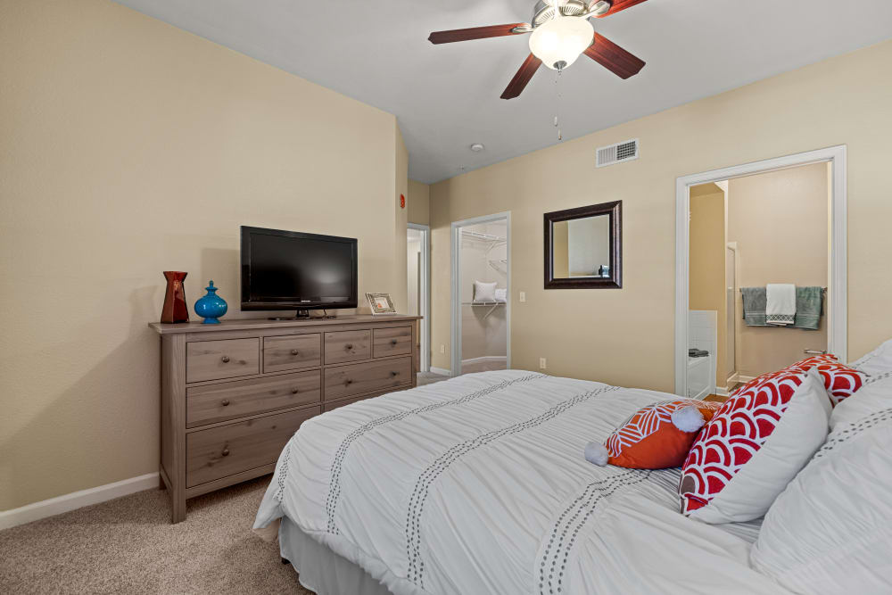 Decorated bedroom with ceiling fan at Marquis at Town Centre