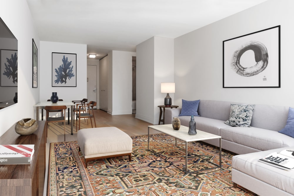 Gorgeous living room area with a large area rug in the center at The Ventura in New York, New York