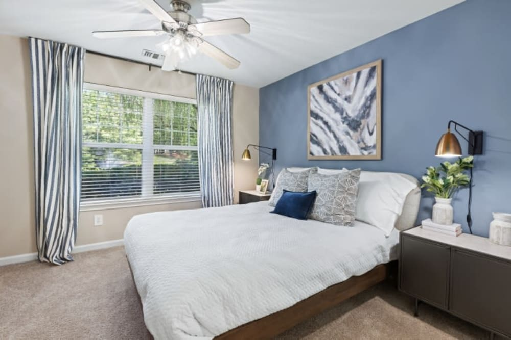 Well lit bedroom in unit at Marquis on Cary Parkway