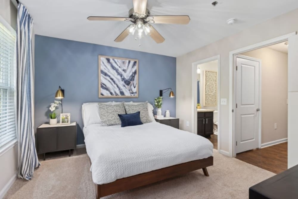 Well decorated main bedroom in unit at Marquis on Cary Parkway