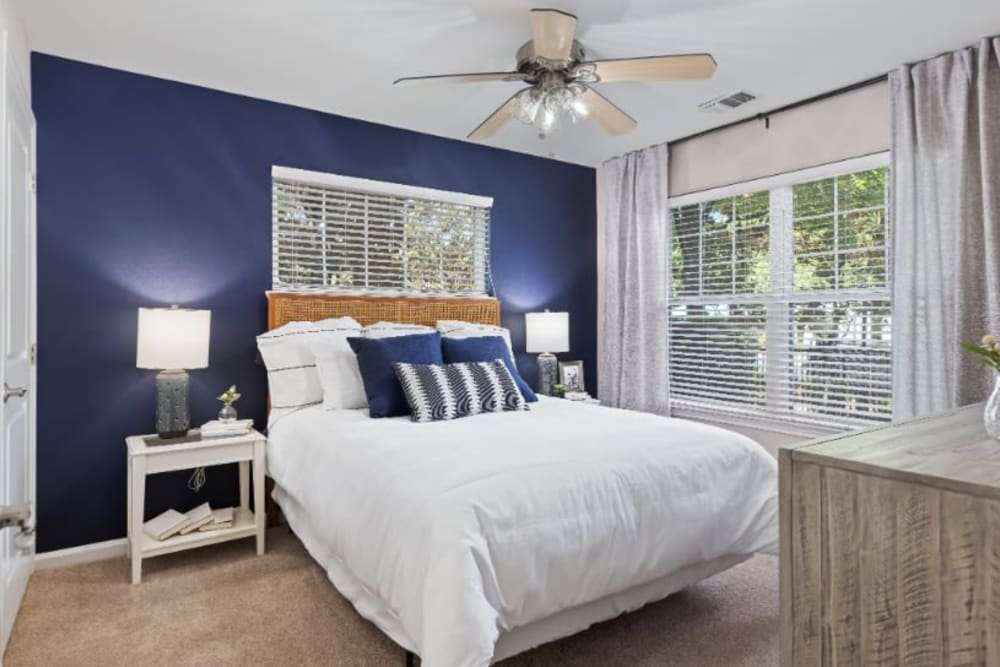 Bedroom with wooden floors and large windows at Marquis on Cary Parkway