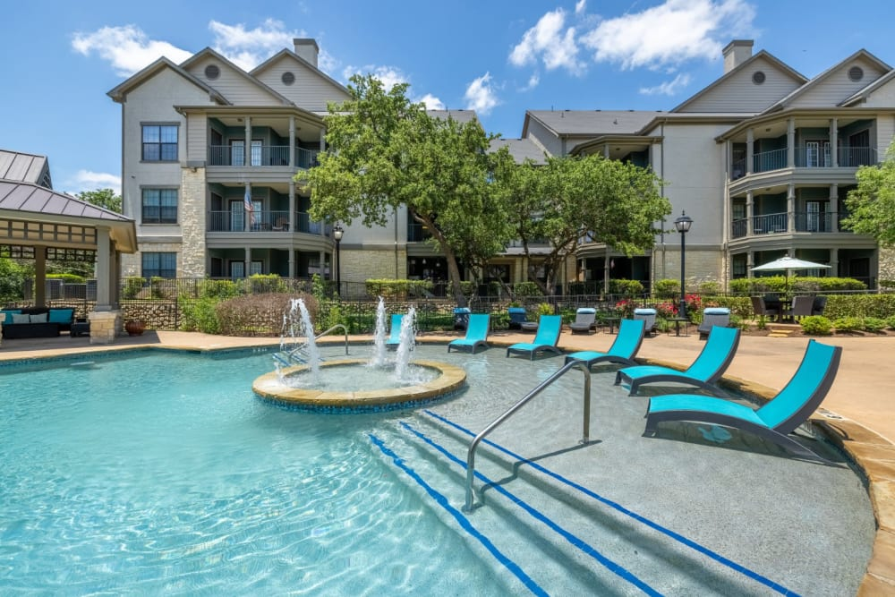 Lounge chairs in shallow water of pool at The Marquis at Brushy Creek in Austin, Texas
