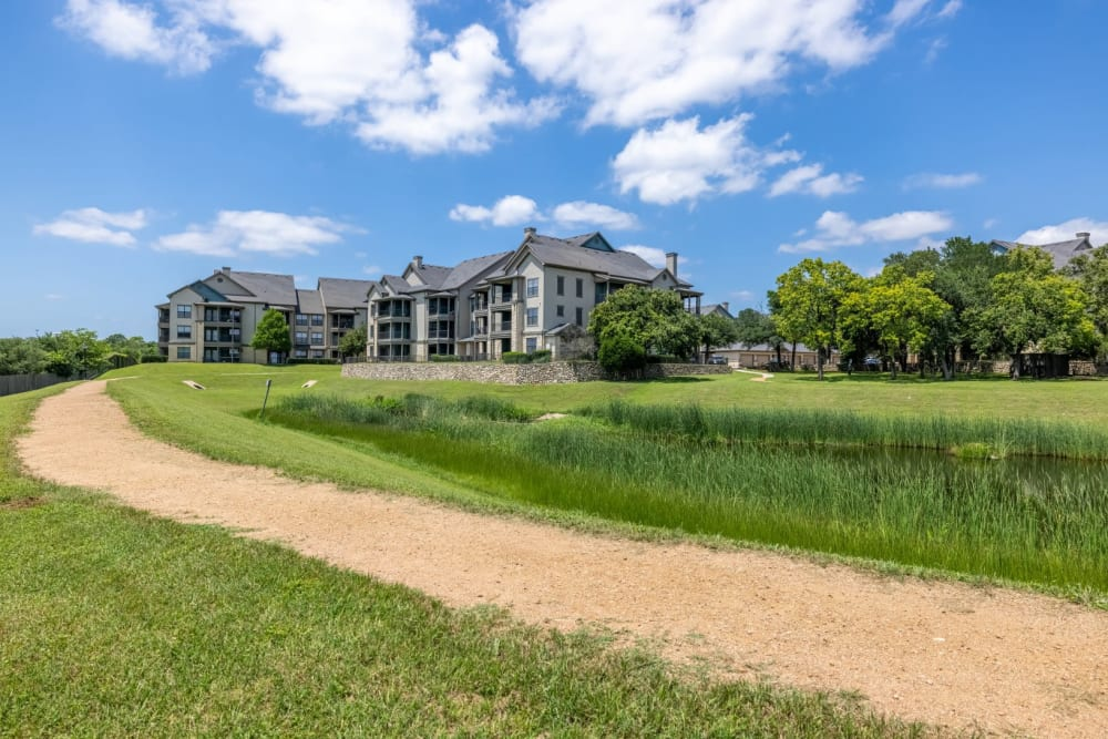 Walkways and plenty of green space outside at The Marquis at Brushy Creek