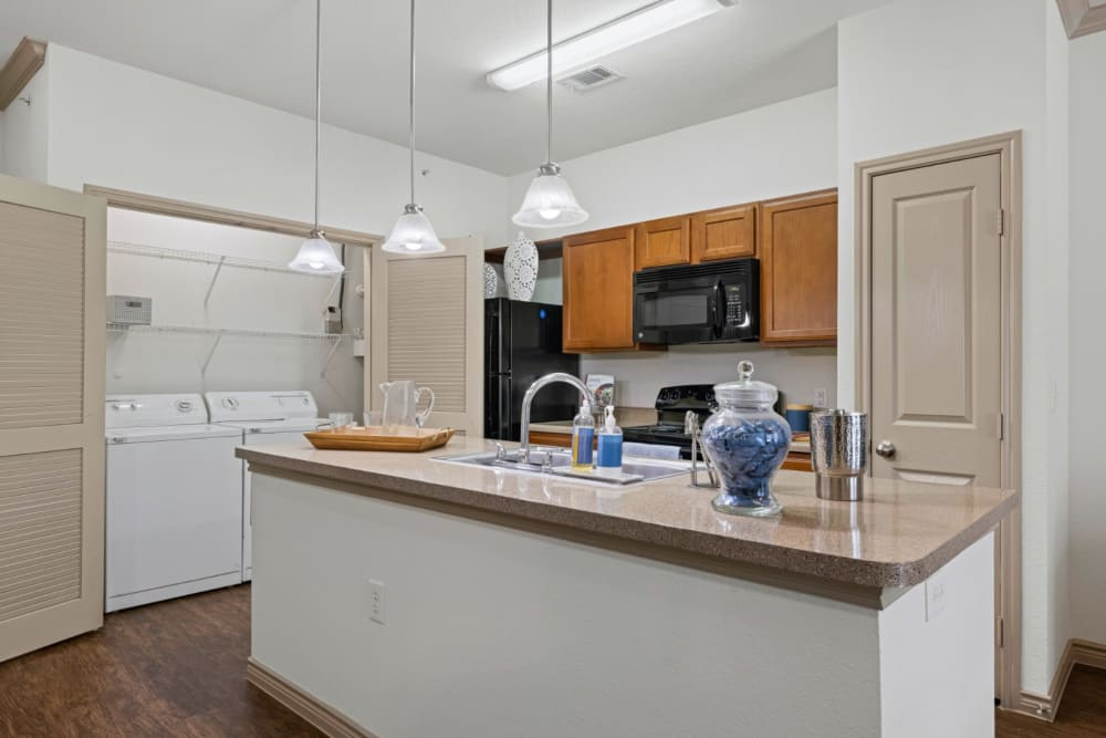 Kitchen with island table at The Marquis at Brushy Creek