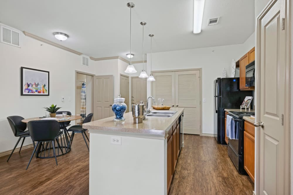 View of dining table from kitchen at The Marquis at Brushy Creek