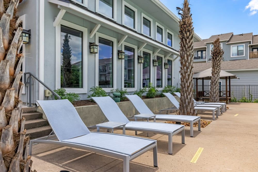 Poolside lounge chairs at Marquis SoCo