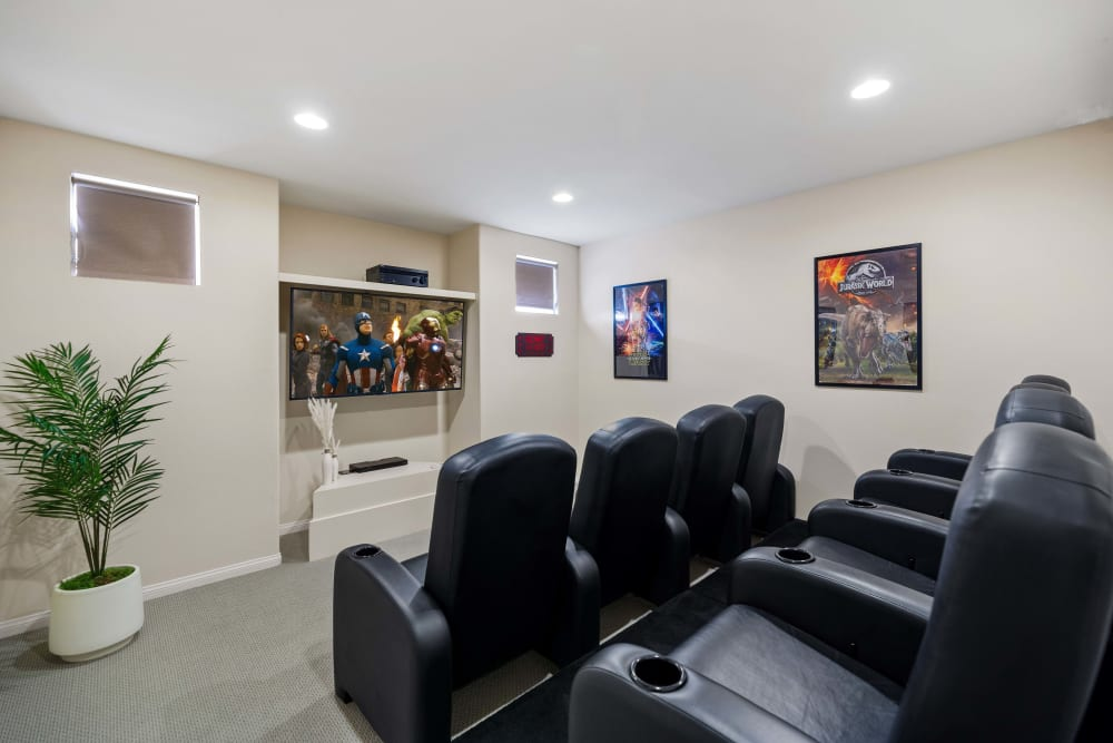 Leather cushioned chairs in private theater room at The Villagio in Northridge, CA