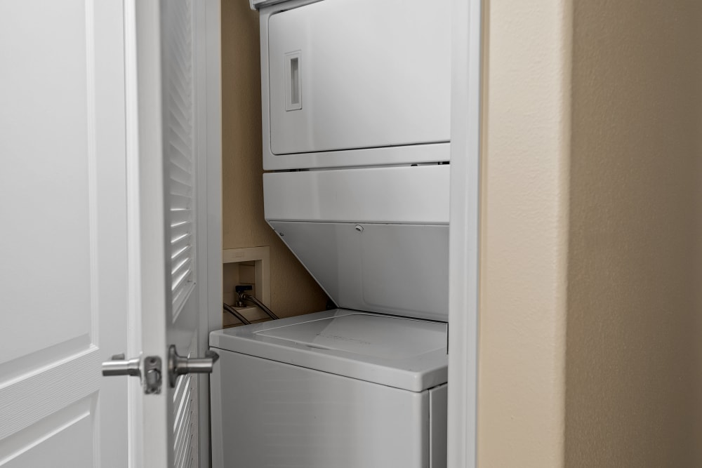 Stacked in-unit washer and dryer at The Villagio in Northridge, CA