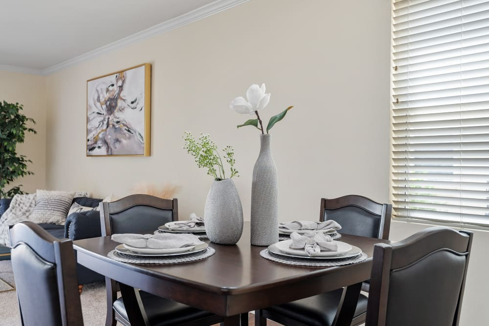 Dining table in open floor plan living space at The Villagio in Northridge, CA