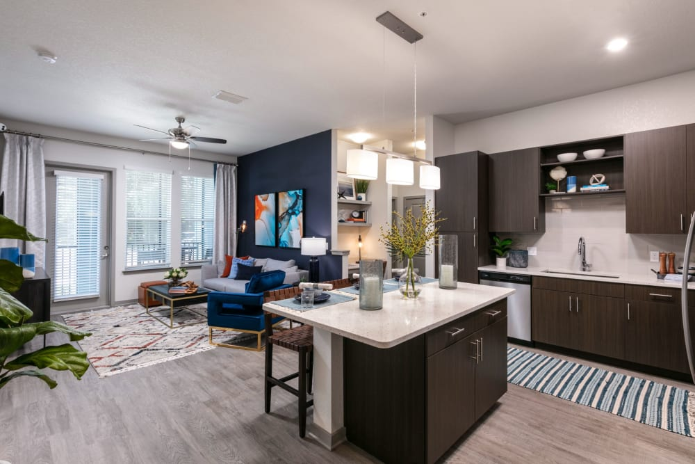 Modern kitchen with an island at Integra Crossings in Sanford, Florida