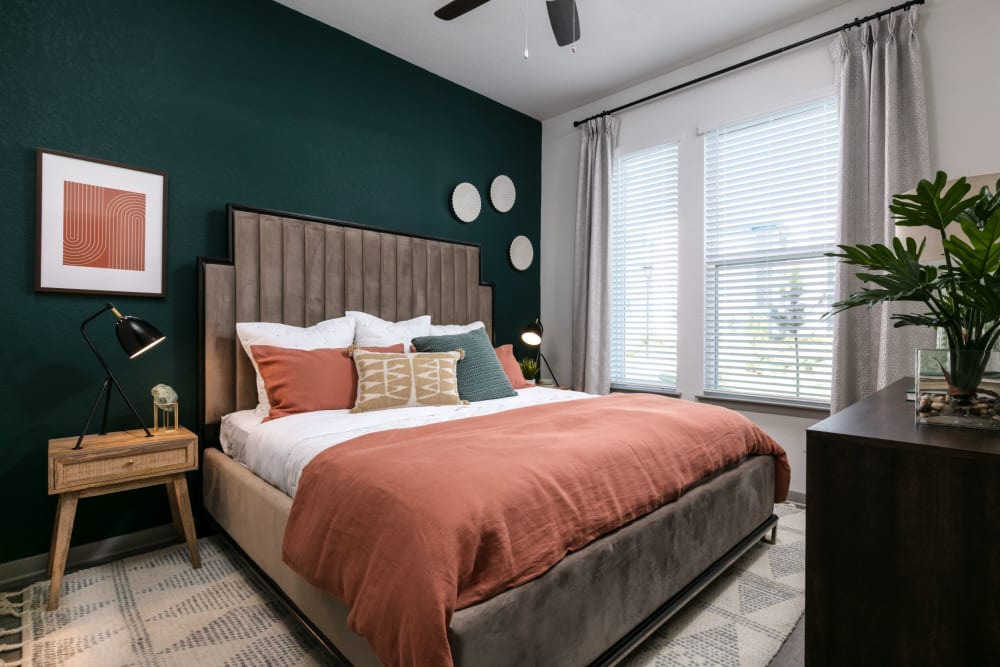Bedroom with an accent wall at Integra Crossings in Sanford, Florida