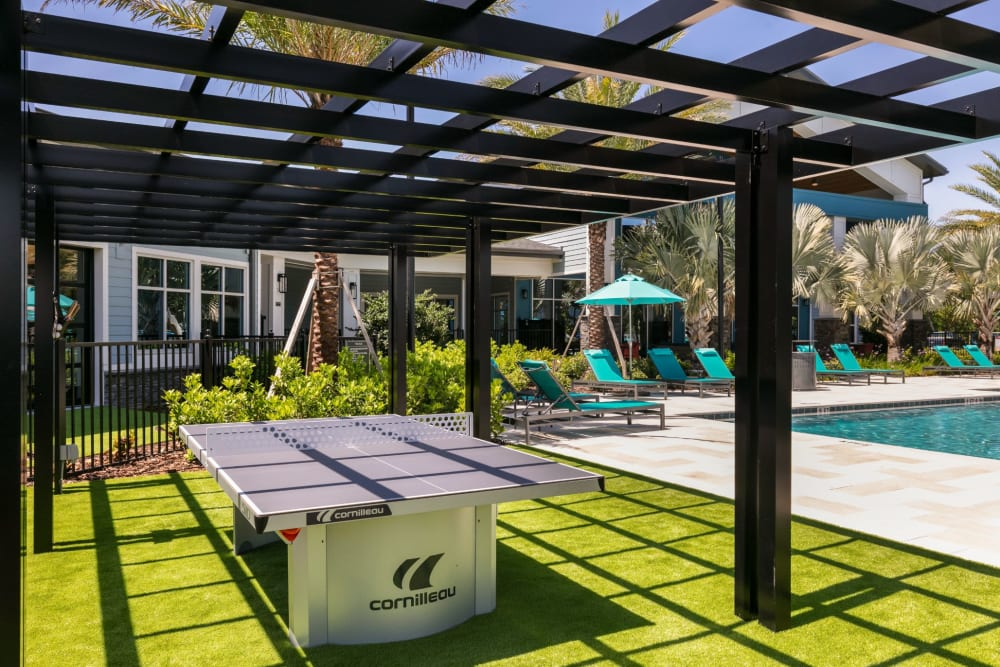 Poolside ping pong table at Integra Crossings in Sanford, Florida