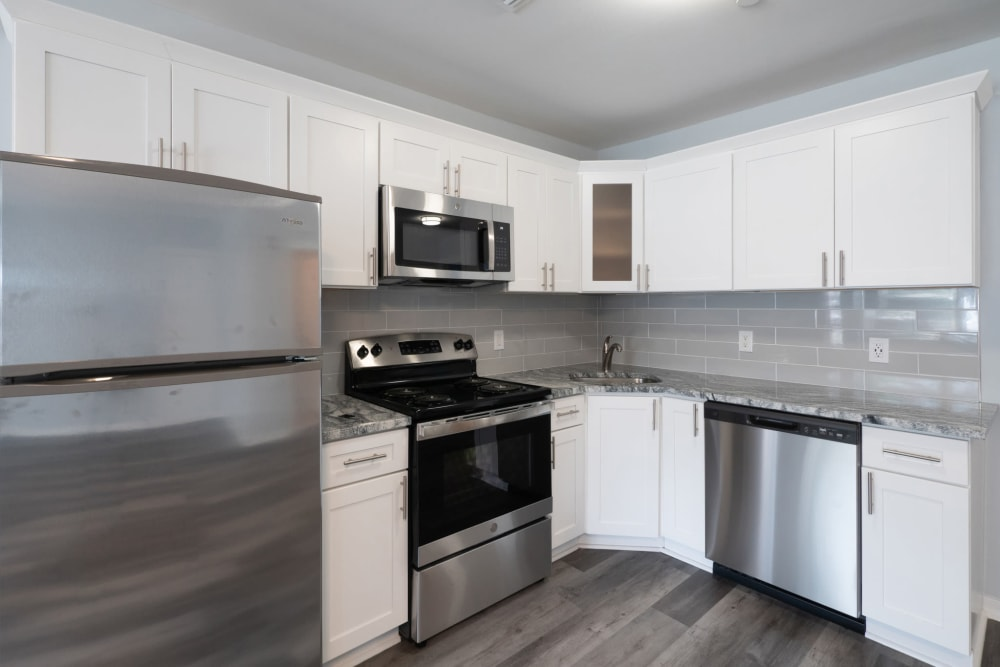 Fully equipped kitchen at Bunt Commons II in Copiague, New York